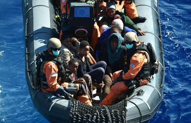 Refugees are transported to a German warship -- that is helping to capture migrant-smugglers trying to cross the Mediteranean Sea, on September 26, 2015 (Alberto Pizzoli (AFP))