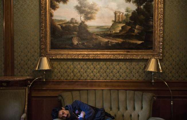 A journalist naps after Iran nuclear talks extended into the early morning at the Beau Rivage Palace Hotel in Lausanne, on April 1, 2015 (Brendan Smialowski (Pool/AFP))