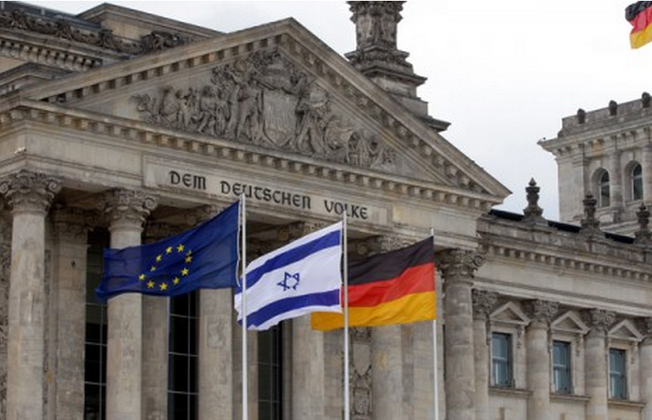 The Israeli flag flies at the Reichstag in Berlin (WOLFGANG KUMM/AFP)