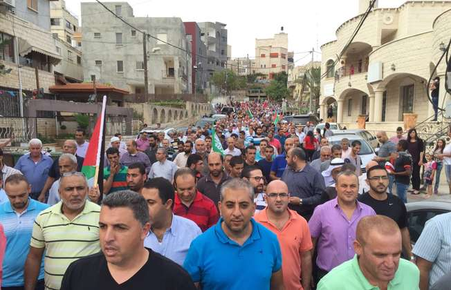 Thousands of Arab-Israelis and Palestinians gather at a demonstration in the town of Sakhnin in northern Israel on October 13, 2015 (Amjad Abu Arafeh/ i24news)