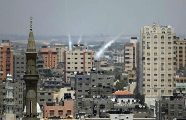 Smoke from rockets fired from Gaza City is seen after being launched toward Israel, on July 15, 2014 (AFP/ Thomas Coex)
