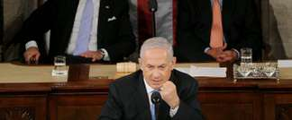 Netanyahu addresses the Congress at the US Capitol with Vice President Joe Biden and House Speaker John Boehner looking on (AFP)