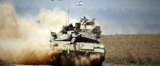 Israeli Merkava tanks roll near the border between Israel and the Gaza Strip as they return from the Hamas-controlled Palestinian coastal enclave on August 5, 2014 (Thomas Coex (AFP/File))