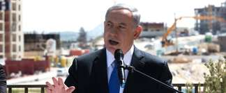 Israeli Prime Minister Benjamin Netanyahu gives a statement to the press during his visit in Har Homa, an Israeli settlement neighbourhood of annexed east Jerusalem, on March 16, 2015 (Menahem Kahana (AFP))