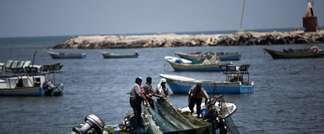 Pêcheurs gazaouis, le 6 juillet 2014: Après 50 jours de conflit meurtrier et des négociations ardues en Egypte, Israël a finalement accepté de rétablir à six milles nautiques (contre 3 depuis le 6 juillet) la zone de pêche des Palestiniens de Gaza (Mahmud Hams (AFP/Archives))