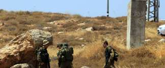 Israeli soldiers inspect the site of an attack that left four Israelis hurt when their car came under fire, near the West Bank settlement of Shvut Rachel on June 30, 2015 (Jaafar Ashtiyeh (AFP))