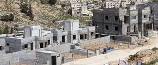 New housing units are seen under construction in the Jewish settlement of Neve Yaakov, near Israel's controversial separation wall in the northern area of east Jerusalem (Ahmad Gharabli (AFP/File))
