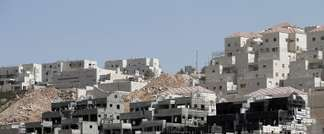 Buildings under construction are seen in the Israeli settlement of Beitar Illit near the Palestinian West Bank village of Wadi Fukin, on September 4, 2014 (Ahmad Gharabli (AFP/File))
