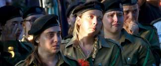 Israeli female soldiers grieve during the funeral of an army tank captain on July 23, 2014, in the central town of Modiin, 30 kilometres from Tel Aviv (Gil Cohen Magen (AFP))