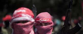 A masked Palestinian militant in Gaza during a rally celebrating the Egypt-mediated ceasefire between Israel and Hamas, September 2, 2014 (Mahmud Hams (AFP))