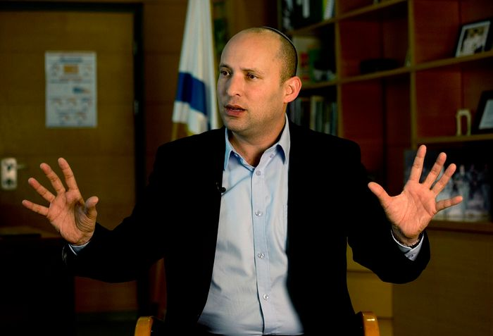 Naftali Bennett, leader of the Jewish Home party, speaks during an interview to the Associated Press in Jerusalem, Monday, Feb. 16, 2015. With Benjamin Netanyahu under fire internationally for his hardline policies, a key partner of Israeli prime minister