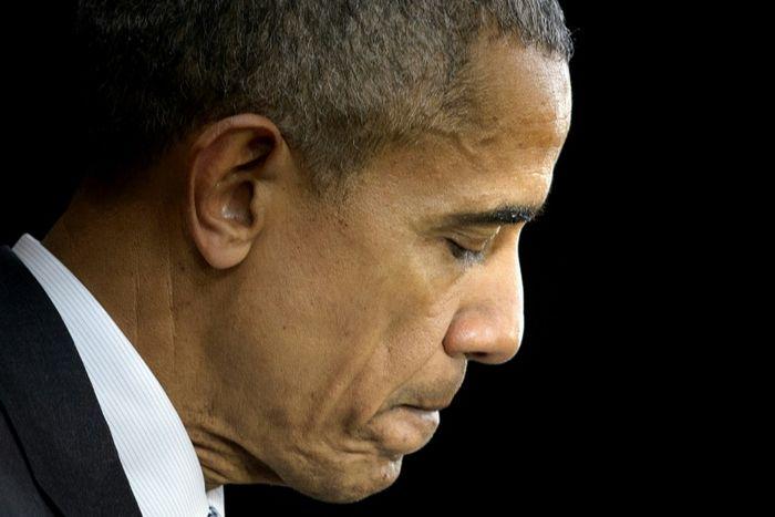 أوباما معزيا (ا ف ب)