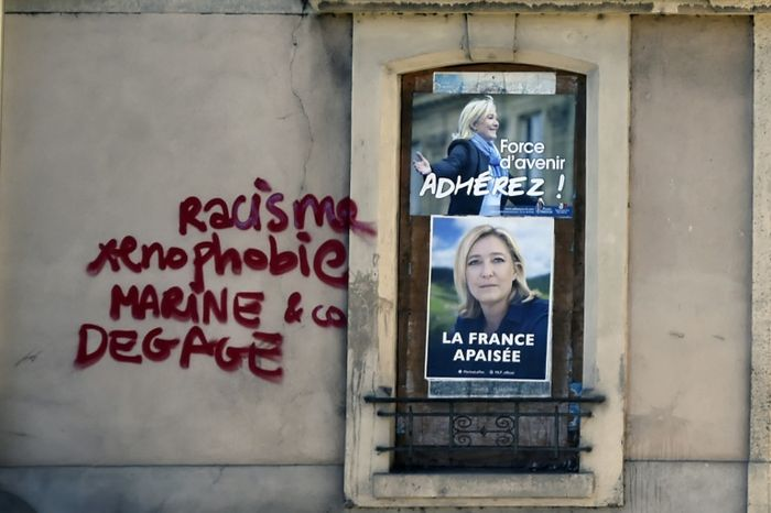 France's Le Pen accuses rival Macron of being soft on Islamists
