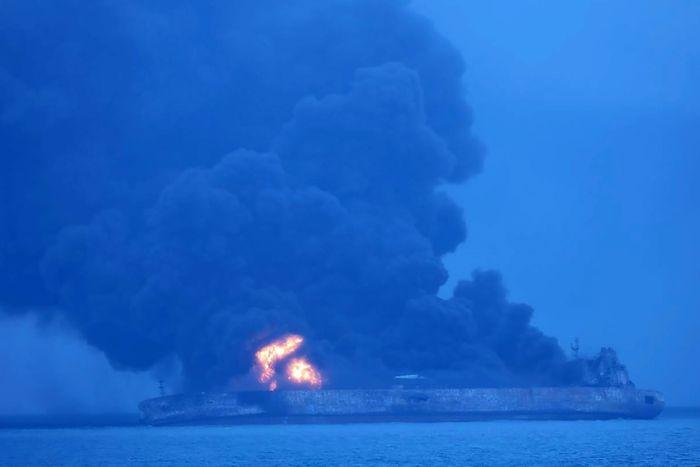 Burning oil tanker off China's coast in danger of exploding