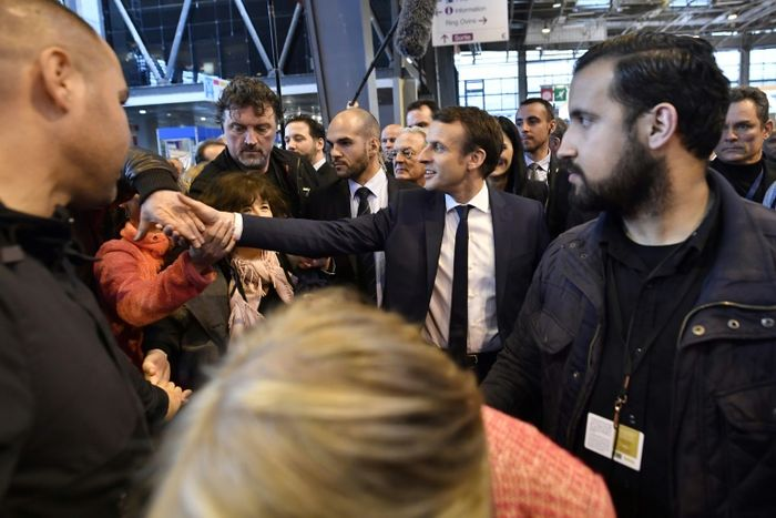 Macron top aide detained for striking May Day protester