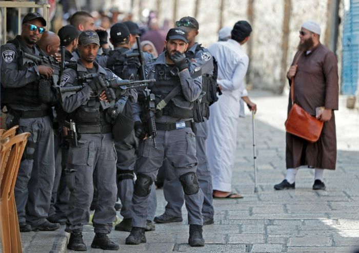 Palestinians pray outside Al-Aqsa mosque after Israeli restrictions