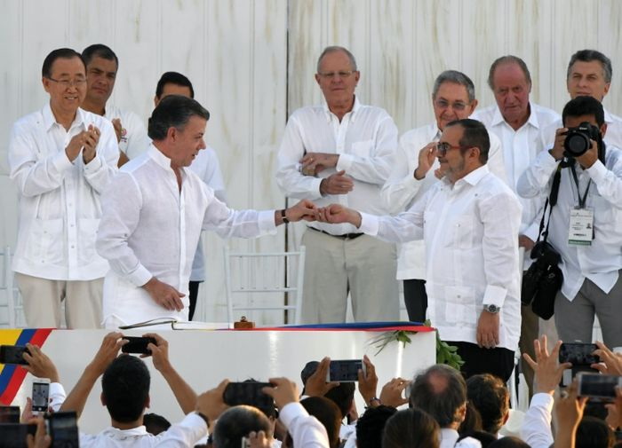 Colombia takes big step to peace as rebels lay down guns