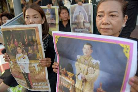 Maha Vajiralongkorn does not enjoy the same level of popularity as his father, King Bhumibol, did ( Tang Chhin Sothy (AFP) )