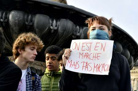 The protests began over fuel taxes but have widened into a broad challenge to Macron's pro-business agenda ( NICOLAS TUCAT (AFP) )