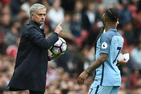Manchester United's manager Jose Mourinho holds onto the ball as Manchester City's Raheem Sterling tries to retrieve it during their English Premier League match, at Old Trafford, on September 10, 2016 ( Oli Scarff (AFP) )