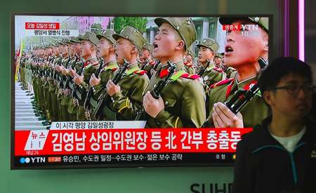 North Korea flaunts long-range missiles in birthday parade