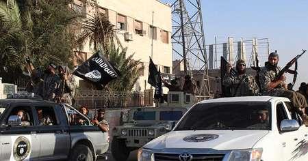 صورة من اعلام ولاية الرقة الجهادي في 30 حزيران/يونيو 2014 يظهر جهاديين يجوبون الرقة ( ولاية الرقة/اف ب/ارشيف )