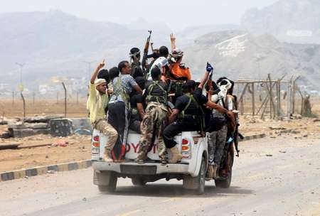 Armed militiamen loyal to Yemen's fugitive President Abderabbo Mansour Hadi drive through the southern Yemeni city of Aden on July 14, 2015 after capturing the airport from Shiite Huthi rebels ( Saleh Al-Obeidi (AFP) )
