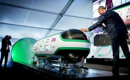 Dutch Minister for economic affairs Henk Kamp checks out the prototype during the unveiling of the Hyper Loop capsule from the Delft University of Technology in Delft, in June 2016 ( Robin van Lonkhuijsen (ANP/AFP/File) )