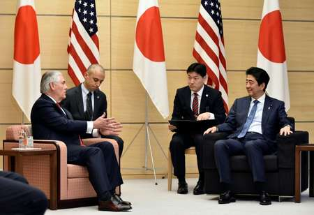 Rex Tillerson (L) speaks to Japanese Prime Minister Shinzo Abe: the US Secretary of State has vowed to press Beijing to rein in North Korea ( FRANCK ROBICHON (POOL/AFP) )