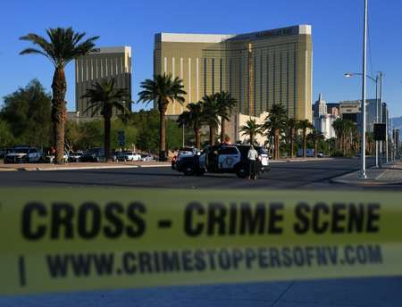 Crime scene tape surrounds the Mandalay Hotel after a gunman killed at least 58 people when he opened fire on a country music concert in Las Vegas, Nevada ( Mark RALSTON (AFP) )