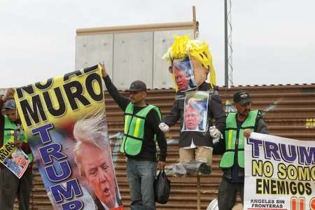 Demonstrators in Tijuana paraded with a pinata version of Trump -- which police persuaded them not to burn ( Guillermo Arias (AFP) )