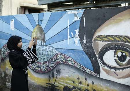 Palestinian Fatma Mosabah, 21, takes pictures for social media to give followers a different view of her native Gaza Strip from what much of the world may be used to ( MAHMUD HAMS (AFP) )