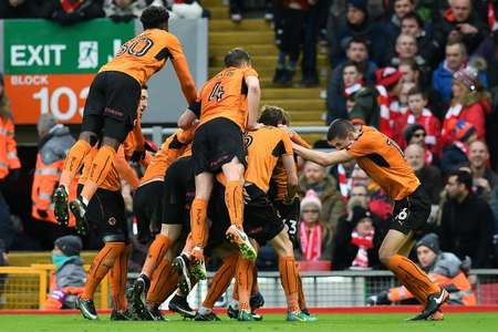 The Wolverhampton Wanderers mob teammate Andreas Weimann after he scored his team's second goal against Liverpool on January 28, 2017 ( Paul ELLIS (AFP) )