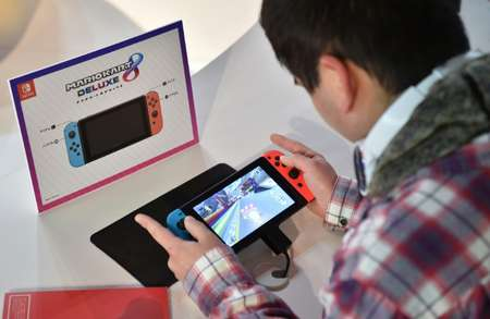 A visitor plays a Nintendo's new Switch game console during its game experience session in Tokyo on January 14, 2017 ( KAZUHIRO NOGI (AFP/File) )