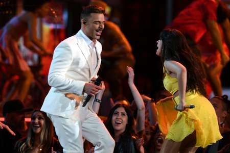 Puerto Rican singer Ricky Martin and US-Cuban singer-songwriter Camila Cabello perform together to open the Grammys ( Robyn Beck (AFP) )
