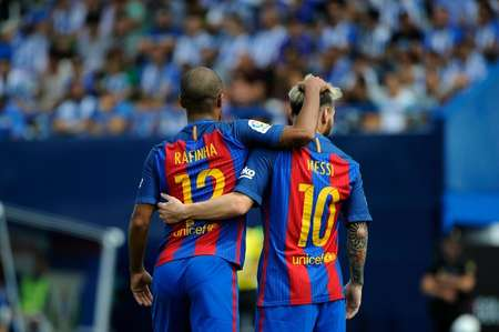 Barcelona players Rafinha (L) and Lionel Messi celebrate a goal during their Spanish league match against hosts Leganes on September 17, 2016 ( Pedro Armestre (AFP) )