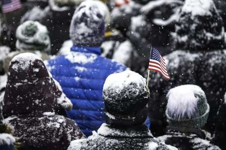 Volunteers at Senator Amy Klobuchar's speech passed out handwarmers on a frigid day under heavy snow ( Kerem Yucel (AFP) )