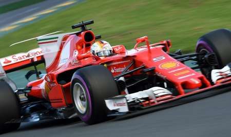 Ferrari's Sebastian Vettel unleashed a best lap of one minute 23.380 seconds to finish top of the timesheets before qualifying at the Australian Grand Prix ( WILLIAM WEST (AFP) )