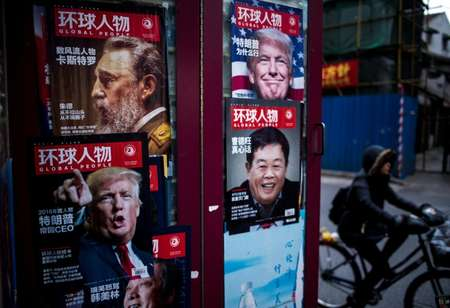 Advertisements for a magazine showing various cover stories, including ones featuring US President-elect Donald Trump, at a newsstand in Shanghai ( Johannes EISELE (AFP) )