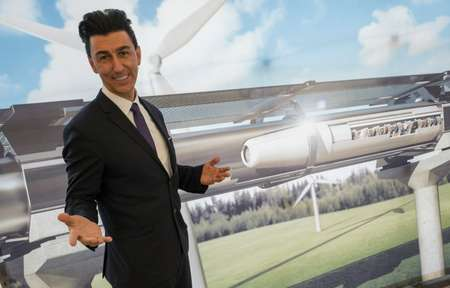 Chairman of Hyperloop Transportation Technologies Inc Bibop Gresta poses in front of a rendering of the Hyperloop technology, at Innotrans, the railway industry's largest trade fair, in Berlin, on September 20, 2016 ( John Macdougall (AFP/File) )