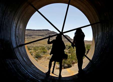 Visitors get a chance to inspect the inside of a Hyperloop tube during the first open air propulsion test at the Hyperloop One Test and Safety site in Las Vegas, Nevada, on May 11, 2016 ( John Gurzinski (AFP/File) )