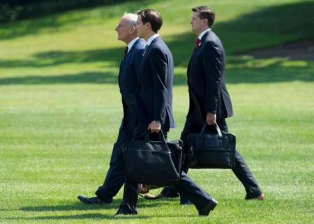 White House staff secretary Rob Porter (R), seen walking to Marine One last August with White House Chief of Staff John Kelly (L), and Senior Adviser Jared Kushner ( SAUL LOEB (AFP/File) )