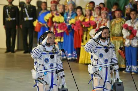 Chinese astronauts Jing Haipeng (L) and Chen Dong salute during the send-off ceremony of the Shenzhou-11 manned space mission, at the Jiuquan Satellite Launch Center in north-western Gansu Province, on October 17, 2016 ( - (AFP) )