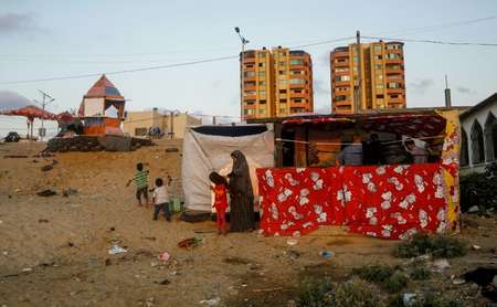 Hani and Noor al-Laham's financial woes have forced them to move to a homemade shack on the coast near Gaza City ( MOHAMMED ABED (AFP) )