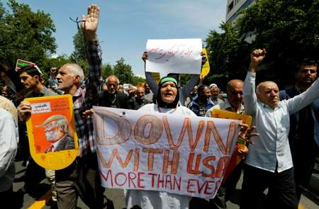 Iranians hold placards bearing anti-US slogans during a demonstration after Friday prayers in the capital Tehran