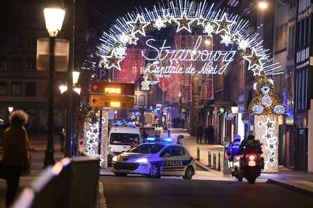 Shortly after the shooting, lines of police vehicles and ambulances streamed into the market area, under festive lights declaring the city the