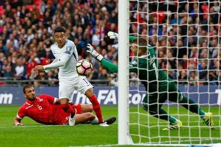 Malta's goalkeeper Andrew Hogg (right) saved many England shots ( Ian Kington (AFP) )