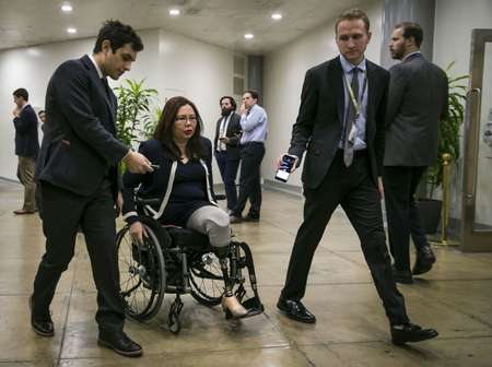 Military veteran and Democratic Senator Tammy Duckworth (C) fired back at President Donald Trump's suggestion Democrats were