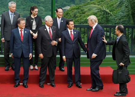 Weeks after being sworn into office, Ardern was rubbing shoulders with world leaders including Donald Tump and South Korea's President Moon Jae-in at a major regional summit  ( JORGE SILVA (POOL/AFP/File) )