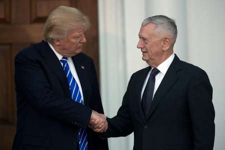 US President-elect Donald Trump shakes hands with retired United States Marine Corps General James Mattis after their meeting at Trump International Golf Club, in Bedminster, New Jersey ( Drew Angerer (GETTY IMAGES NORTH AMERICA/AFP/File) )